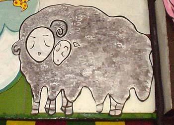 名古屋大須の謎タコ焼き屋看板。隣にバニーさんとか孫悟空とかいて十二支揃ってる。
